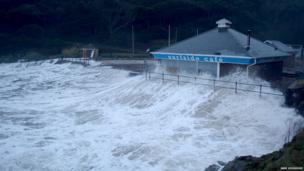 Surfside Cafe at Caswell Bay is pounded by waves