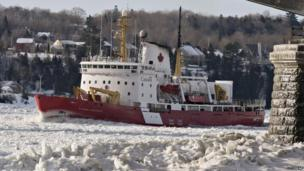 A Canadian Coast Guard ice breaker Pierre-Radisson clears the ice flow under the Quebec bridge on the St-Lawrence River