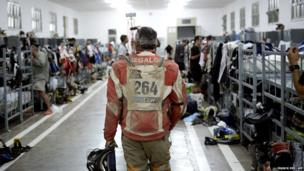 Bikers arrive in the bivouac in Barreal after the Stage three of the Dakar 2014 rally