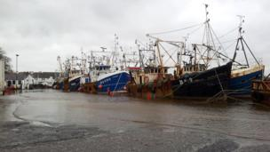 Boats in flooded harbour