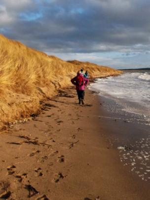 People walking along a beach