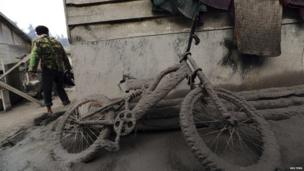 Bicycle covered in ash