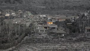 Houses covered in ash