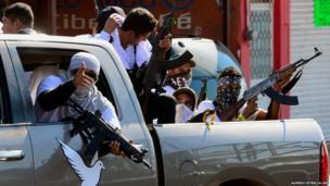 A group of vigilantes enter Nueva Italia