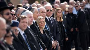US Vice President Joe Biden (C-R) stand next to Benjamin Netanyahu and his wife and Tony Blair at the start of a state memorial ceremony for Ariel Sharon at the Knesset in Jerusalem on 13 January