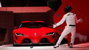 Toyota FT-1 concept car is unveiled on stage by an actor