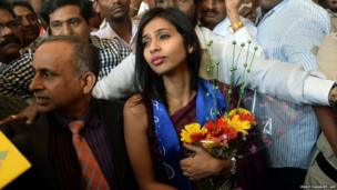Indian diplomat Devyani Khobragade (R), accompanied by her father Uttam Khobragade, arrives at the domestic airport in Mumbai on 14 January 14 2014