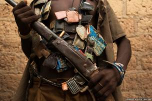 An anti-balaka militiaman poses for a photograph on the outskirts of the capital of the Central African Republic Bangui