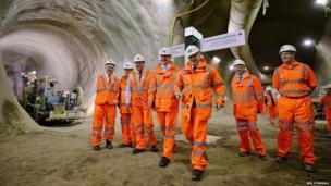 Prime Minister David Cameron (CL) and Mayor of London Boris Johnson (CR) visit a Crossrail construction site underneath Tottenham Court Road