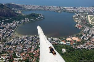 A worker inspects the statue of Christ the Redeemer which was damaged during lightning storms in Rio de Janeiro