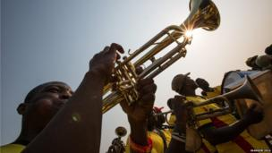 Musicians play in honour of the Queen's baton at a ceremonial event at Flagstaff House, Accra, Ghana.