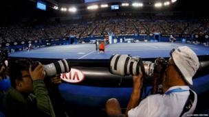Photographers at the Australian Open tennis tournament in Melbourne
