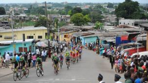 Cyclists compete during the seventh and last stage of the Tour du Gabon on 19 January 2014 in Libreville