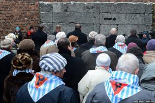 Former concentration camp prisoners attend a ceremony at the memorial site of the former Nazi concentration camp Auschwitz-Birkenau in Oswiecim, Poland
