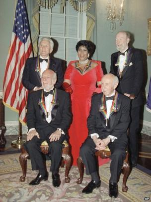 Pete Seeger, back right, with singer Aretha Franklin, actor Kirk Douglas, composer Morton Gould and director Harold Prince, following a 1994 dinner at the State Department in Washington.