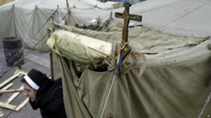 Nun exits a tent set up as a church in Kiev's Independence Square (28 January 2014)