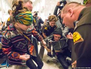 Supporters of same-sex marriage are removed by the Utah Highway Patrol