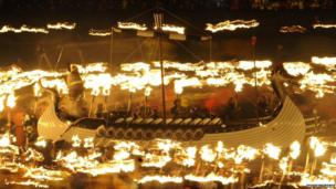 longboat and flames