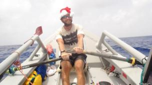 James Ketchell rowing wearing a santa hat