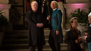 """Philip Seymour Hoffman as Plutarch Heavensbee, left, and Woody Harrelson as Haymitch Abernathy in a scene from """"The Hunger Games: Catching Fire."""""""