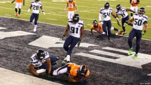 Running back Knowshon Moreno of the Denver Broncos recovers the ball in the endzone.