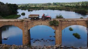 Tractor on a bridge