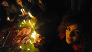 A woman pictured at a candlelight vigil for assassinated politician Chokri Belaid in Tunis, Tunisia - Wednesday 5 February 2014