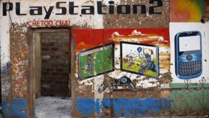 A looted shop painted with Play Station and mobile phone graphics in Bangui, CAR - Tuesday 4 February 2014