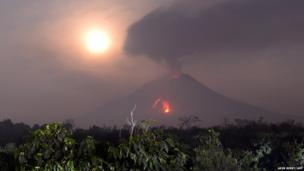 Hot lava runs down from Sinabung volcano