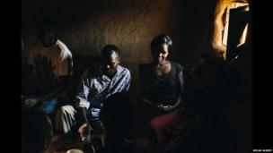 """Members of a """"drinking club"""" in western Kenya"""