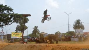 A rider competes in the seniors category on the first day of the National Motocross Championships in Abidjan, Ivory Coast