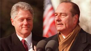 File photo dated 1 February 1996 shows US President Bill Clinton watching French President Jacques Chirac delivering a speech during arrival ceremonies on the South Lawn of the White House in Washington DC