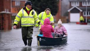 Volunteers help residents brave the flood water in Purley on Thames.