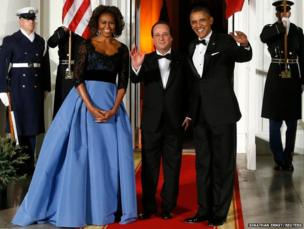 President Barack Obama and his wife Michelle greet French President Francois Hollande (centre) as he arrives for a State Dinner in his honour at the White House in Washington