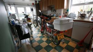 Motorbikes stored in a kitchen