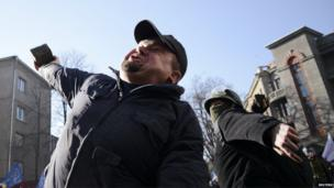 Anti-government protesters throw bricks at Interior Ministry officers in Kiev.