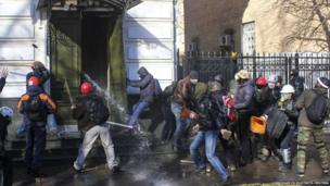 Anti-government protesters attack an office of the pro-presidential Party of the Regions in Kiev