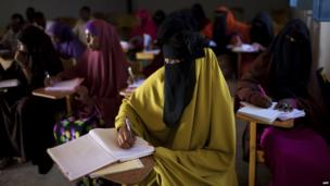 Women at desks in a class at the Hope University, Mogadishu, Somalia - Sunday 16 February 2014