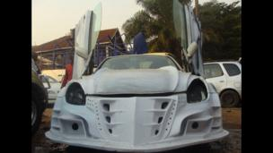 A car being remodelled at Godfrey Namunye's garage in Kampala, Uganda