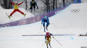 Skiers jumping
