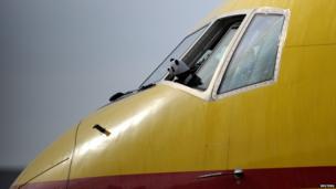 Panda teddy on a yellow plane