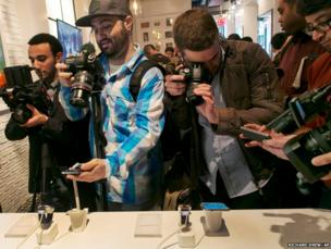 Photographers swarm around the new Samsung Galaxy S5 smartphones and Samsung Gear 2's in New York