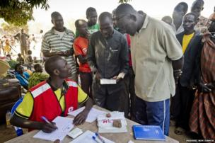 Matiop registers himself and his family with the Uganda Red Cross