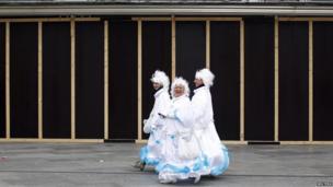 "Women dressed in costumes for Cologne's ""Weiberfastnacht"" (Women""s Carnival), marking the start of a week of street festivals"