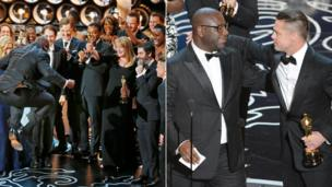 Steve McQueen accepts best picture and has a hug from Brad Pitt.