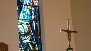 A cross and stained glass window