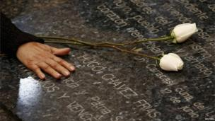 Hugo Chavez's mother, Elena Frias, puts flowers on his tomb on 5 March, 2014