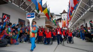 The Great Britain Paralympic team make their way to the welcome ceremony in the Athletes Village.
