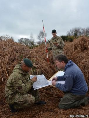 Ministry of Defence archaeologist Richard Osgood, with Lieutenant Corporal Robert Walters and Rifleman Stuart Gray, of the 4th Battalion The Rifles, surveys the front line trench of a newly discovered practice World War One battlefield in Gosport, Hampshire