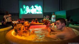 Film fans enjoy a hot bubble bath while watching a movie at the Hot Tub Movie Club in Amsterdam, Netherlands